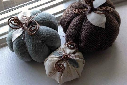 Stuffed and sewn fabric pumpkins